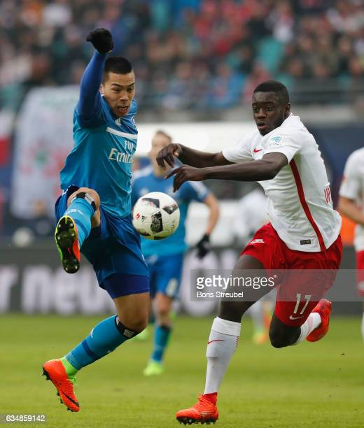 Bobby Wood of Hamburger SV is challenged by Dayot Upamecano of RB Leipzig during the Bundesliga match between RB Leipzig and Hamburger SV at Red Bull...