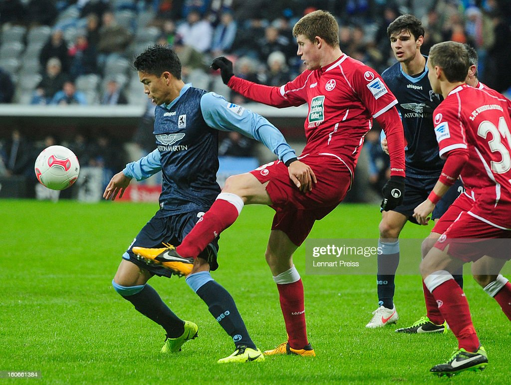 Bobby Wood (L) of Muenchen challenges Florian Riedel of Kaiserslautern during the Second Bundesliga match between TSV 1860 Muenchen and 1. FC Kaiserslautern at Allianz Arena on February 4, 2013 in Munich, Germany.