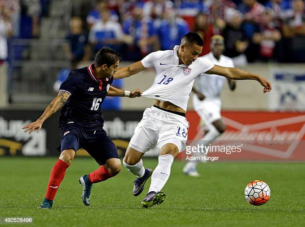Bobby Wood of the United States and Christian Gamboa of Costa Rica battle for the ball during the second half at Red Bull Arena on October 13 2015 in...
