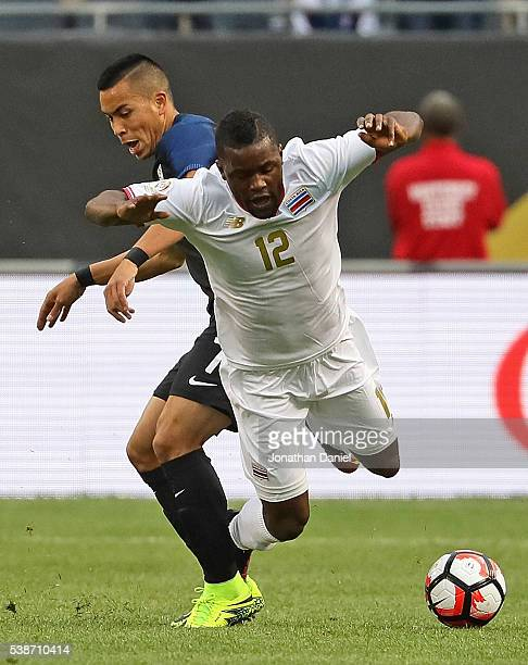 Bobby Wood of the United States takes odwn Joel Campbell of Costa Rica during a match in the 2016 Copa America Centenario at Soldier Field on June 7...
