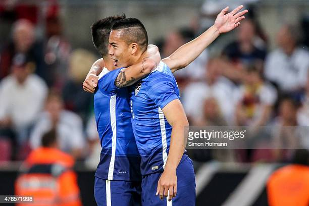 Bobby Wood of the USA celebrates his team's second goal during the International Friendly match between Germany and USA at RheinEnergieStadion on...