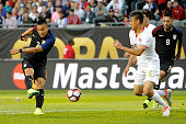 Bobby Wood of United States shoots to score the third goal of his team during a group A match between United States and Costa Rica at Soldier Field...