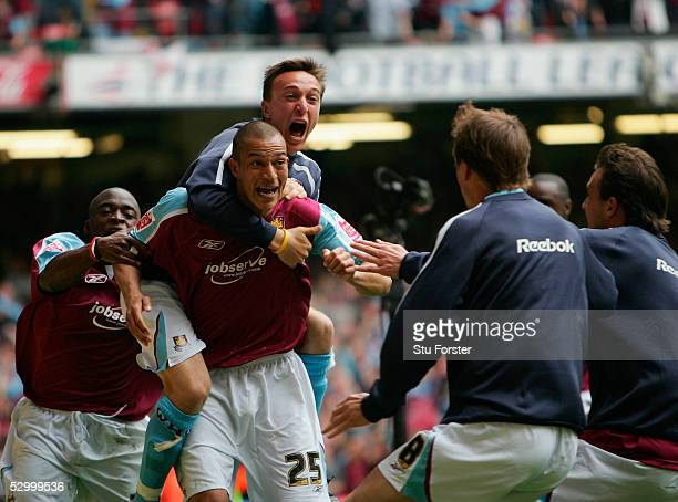 Bobby Zamora celebrates with Mark Noble on his back after scoring the first West Ham goal during the Coca Cola Championship Play Off Final match...