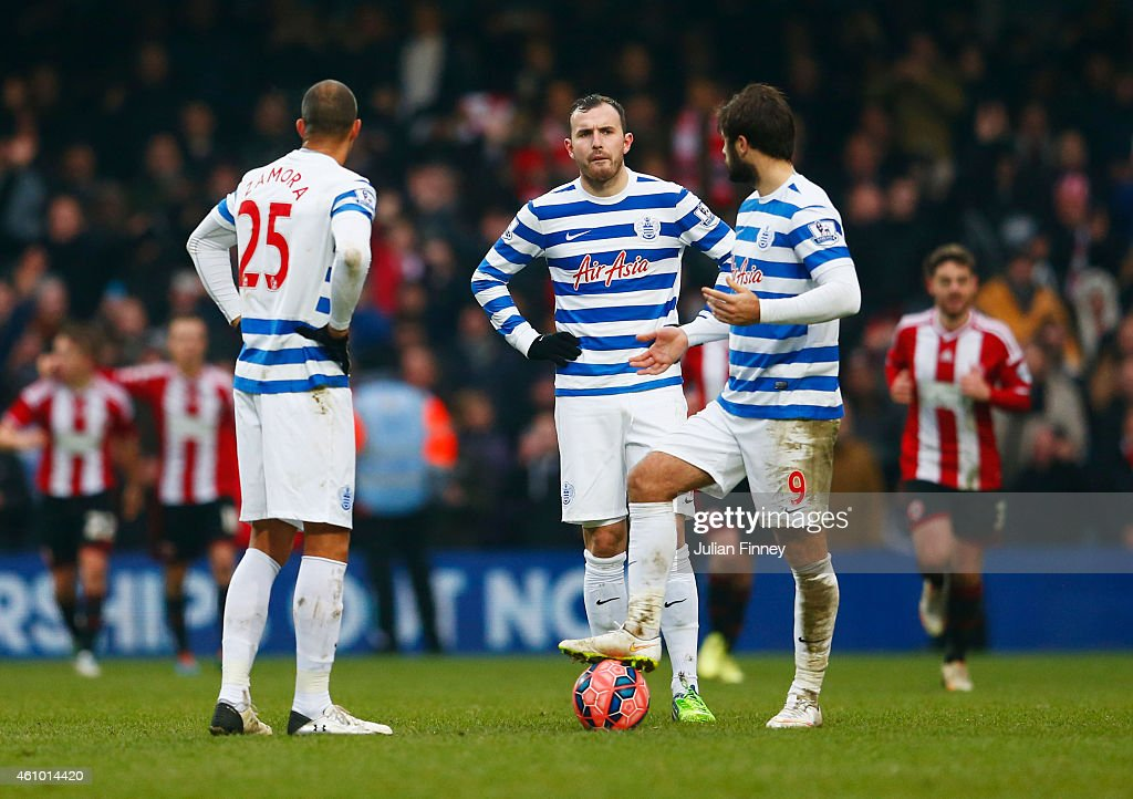 Bobby Zamora, Jordan Mutch and Charlie Austin of QPR look dejected as Jamal Campbell-Ryce of Sheffield United (not pictured) scores their third goal during the FA Cup Third Round match between Queens Park Rangers and Sheffield United at Loftus Road on January 4, 2015 in London, England.
