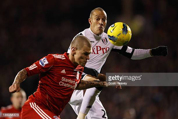 Bobby Zamora of Fulham challenges Martin Skrtel of Liverpool during the Barclays Premier League match between Fulham and Liverpool at Craven Cottage...