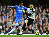 Bobby Zamora of Fulham holds off John Obi Mikel of Chelsea during the Barclays Premier League match between Chelsea and Fulham at Stamford Bridge on...