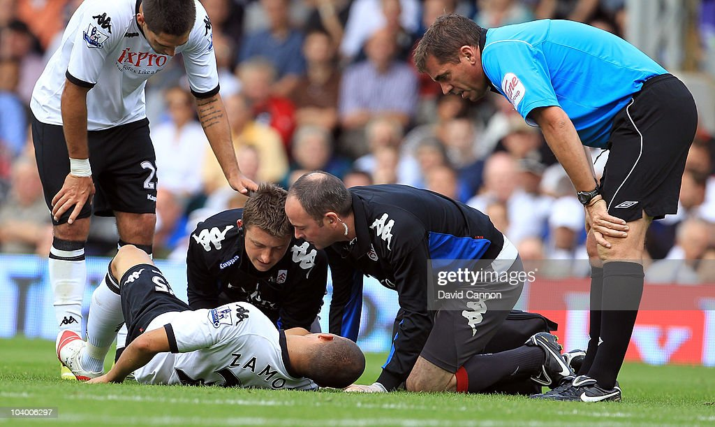 <a gi-track='captionPersonalityLinkClicked' href=/galleries/search?phrase=Bobby+Zamora&family=editorial&specificpeople=207020 ng-click='$event.stopPropagation()'>Bobby Zamora</a> of Fulham lies injured with a broken leg as referee Phil Dowd shows concern during the Barclays Premier League match between Fulham and Wolverhampton Wanderers at Craven Cottage on September 11, 2010 in London, England.