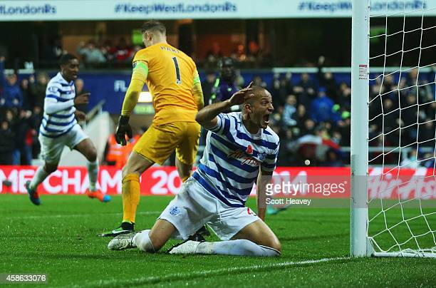 Bobby Zamora of QPR celebrates as Martin Demichelis of Manchester City scores an own goal for QPR's second goal during the Barclays Premier League...