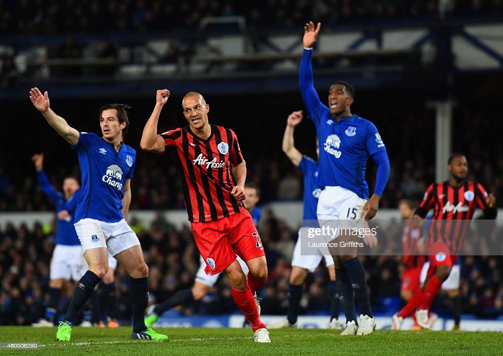 Bobby Zamora of QPR celebrates scoring their first goal as Leighton Baines (L) and Sylvain Distin of Everton appeal during the Barclays Premier League match between Everton and Queens Park Rangers at Goodison Park on December 15, 2014 in Liverpool, England.