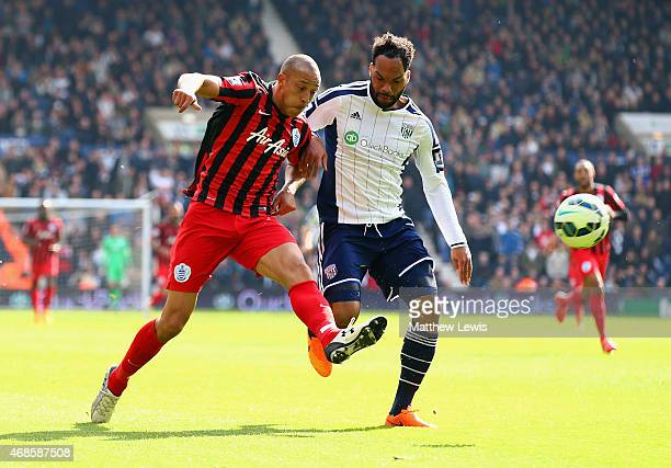 Bobby Zamora of QPR scores their third goal under pressure from Joleon Lescott of West Brom during the Barclays Premier league match West Bromwich...