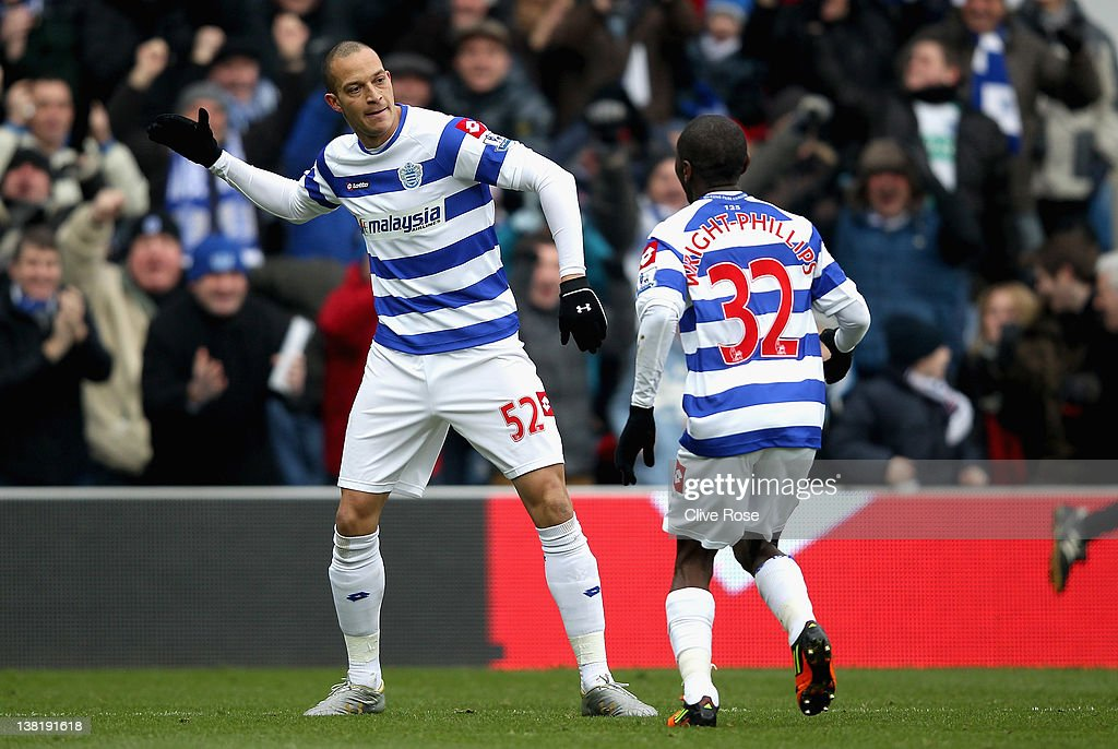 Bobby Zamora of Queens Park Rangers celebrates scoring the opening goal with teammate Shaun WrightPhillips during the Barclays Premier League match...