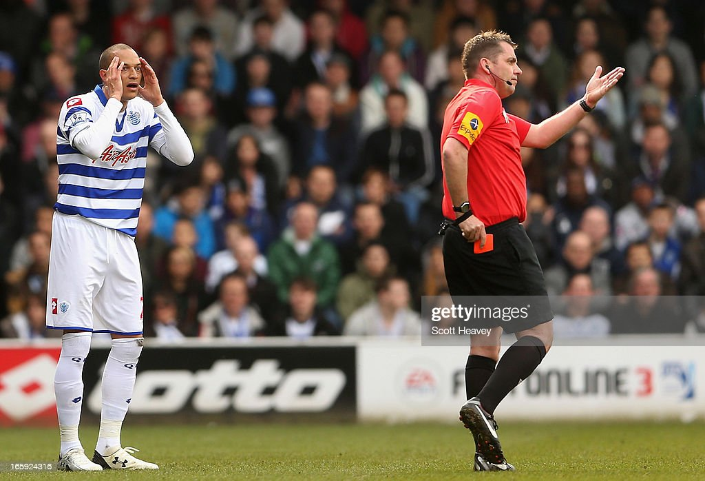 <a gi-track='captionPersonalityLinkClicked' href=/galleries/search?phrase=Bobby+Zamora&family=editorial&specificpeople=207020 ng-click='$event.stopPropagation()'>Bobby Zamora</a> of Queens Park Rangers reacts after being shown a red card and sent off by referee Phil Dowd during the Barclays Premier League match between Queens Park Rangers and Wigan Athletic at Loftus Road on April 7, 2013 in London, England.