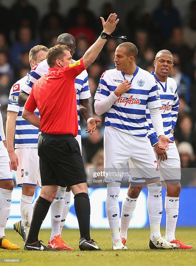 <a gi-track='captionPersonalityLinkClicked' href=/galleries/search?phrase=Bobby+Zamora&family=editorial&specificpeople=207020 ng-click='$event.stopPropagation()'>Bobby Zamora</a> of Queens Park Rangers (second right) reacts after being shown a red card and sent off by referee Phil Dowd during the Barclays Premier League match between Queens Park Rangers and Wigan Athletic at Loftus Road on April 7, 2013 in London, England.