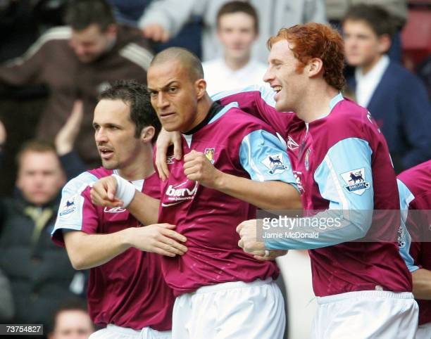 Bobby Zamora of West Ham is congratulated by teammates Matthew Etherington and James Collins after scoring the opening goal during the Barclays...