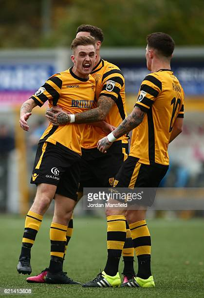 BobbyJoe Taylor of Maidstone United celebrates with team mates as he scores their first goal from the penalty spot during The Emirates FA Cup first...