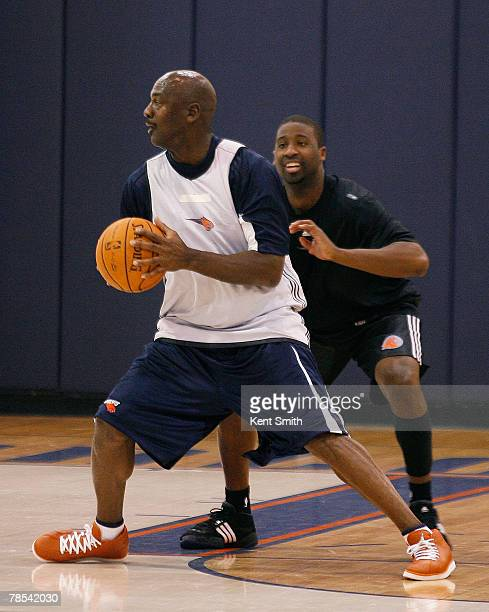 Bobcats Managing Member of Basketball Operations Michael Jordan practices with Raymond Felton of the Charlotte Bobcats on December 18 2007 at the...