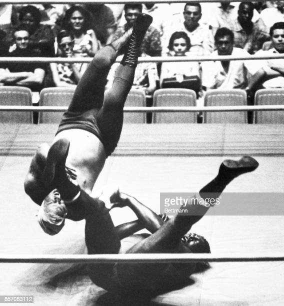 Bobo Brazil flips champion Buddy Austin on his head guard in second fall action at the Olympic Auditorium Austin took the first guard in first fall...