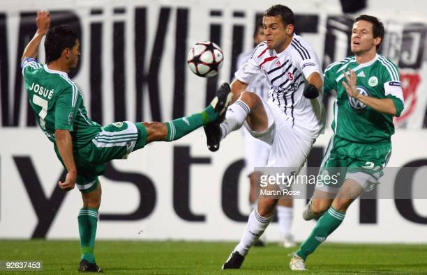 Bobo of Besiktas Josue and Sascha Riether of Wolfsburg compete for the ball during the UEFA Champions League Group B match between Besiktas Istanbul...