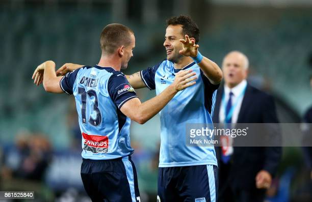 Bobo of Sydney celebrates scoring a goal with team mates during the round two ALeague match between Sydney FC and the Wellington Phoenix at Allianz...