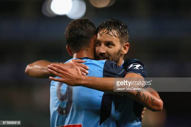 Bobo of Sydney celebrates with Milos Ninkovic of Sydney after scoring a goal during the round seven ALeague match between Sydney FC and Newcastle...
