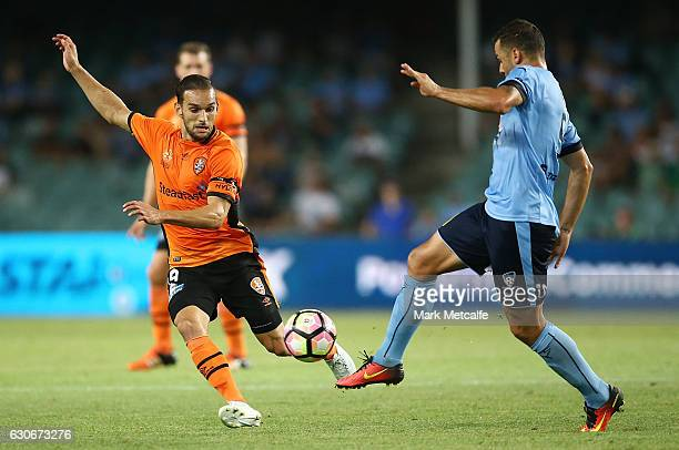 Bobo of Sydney FC and Jack Hingert of the Roar compete for the ball during the round 13 ALeague match between Sydney FC and Brisbane Roar at Allianz...