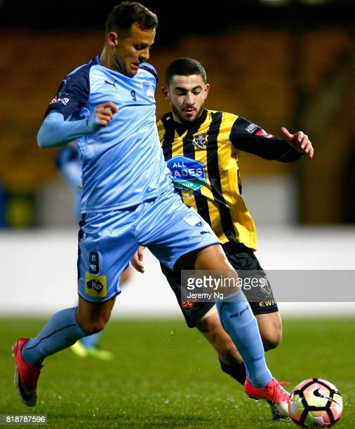 Bobo of Sydney FC and Michael Loupis of the Wanderers challenge for the ball during the 2017 Johnny Warren Challenge match between Sydney FC and...