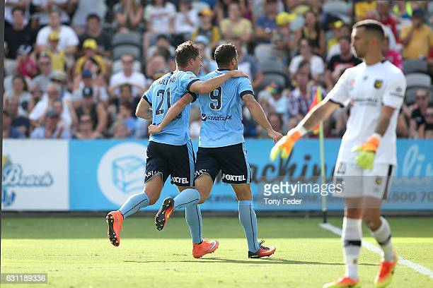 Bobo of Sydney FC celebrates a goal with team mate Filip Holosko during the round 14 ALeague match between the Central Coast Mariners and Sydney FC...