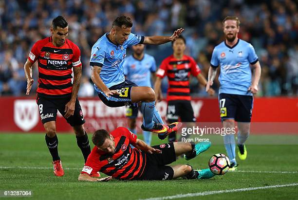 Bobo of Sydney FC is tacked by Robbie Cornthwaite of the Wanderers during the round one ALeague match between the Western Sydney Wanderers and Sydney...
