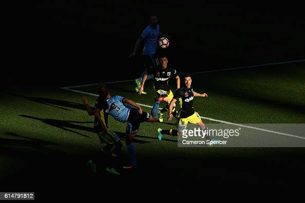 Bobo of Sydney FC kicks the ball ahead of Nick Montgomery of the Mariners during the round two ALeague match between Sydney FC and the Central Coast...