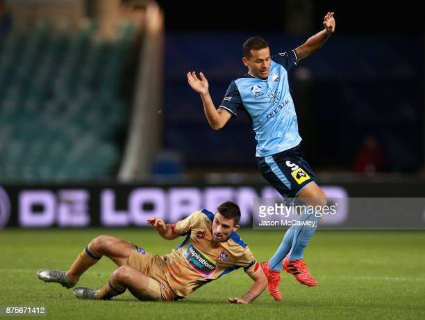 Bobo of Sydney is challenged by Jason Hoffman of the Jets during the round seven ALeague match between Sydney FC and Newcastle Jets at Allianz...
