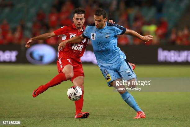 Bobo of Sydney is challenged by Nikola Mileusnic of Adelaide during the FFA Cup Final match between Sydney FC and Adelaide United at Allianz Stadium...