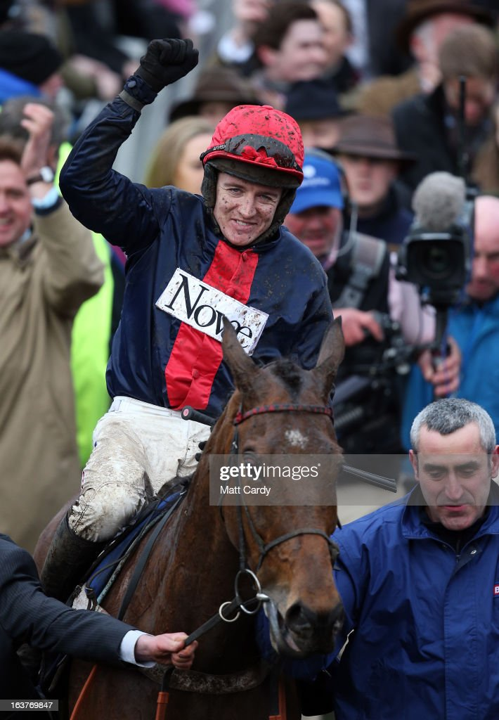 Bobs Worth is ridden by <a gi-track='captionPersonalityLinkClicked' href=/galleries/search?phrase=Barry+Geraghty&family=editorial&specificpeople=198943 ng-click='$event.stopPropagation()'>Barry Geraghty</a> into the parade ring after winning the Gold Cup at Cheltenham Racecourse on the fourth and final day of the Cheltenham Festival 2013 on March 15, 2013 in Cheltenham, England. Approximately 200,000 racing enthusiasts are expected at the four-day festival, which ends today and is seen as many as the highlight of the jump racing calendar