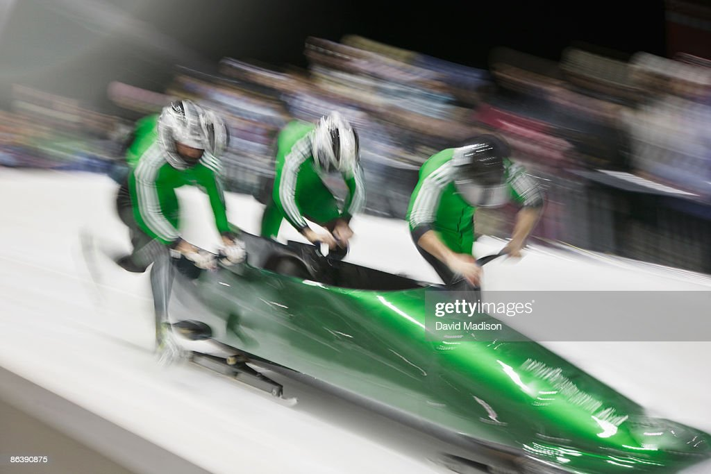Bobsled competition start. : Stock Photo