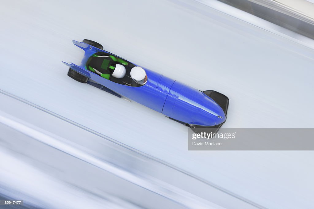 Bobsled on track with Motion blur. : Stock Photo