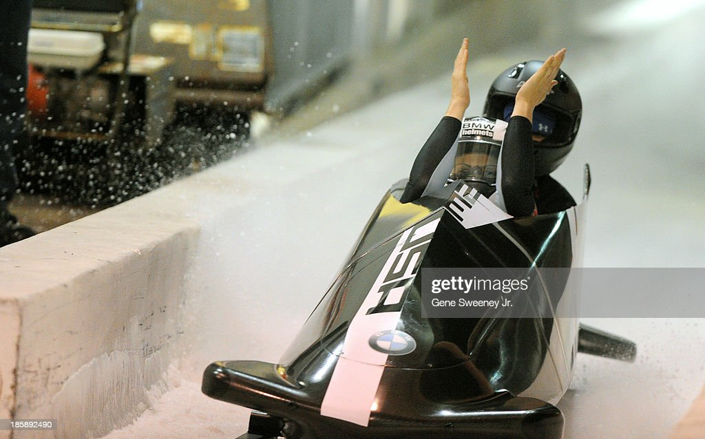 Bobsled pilot Jamie Greubel celebrates crossing the finish line as she and brakewoman Emily Azevedo took first place in the selection race at the Utah Olympic Park October 25, 2013 in Park City, Utah. Their two-run combined time was 1:39.41.