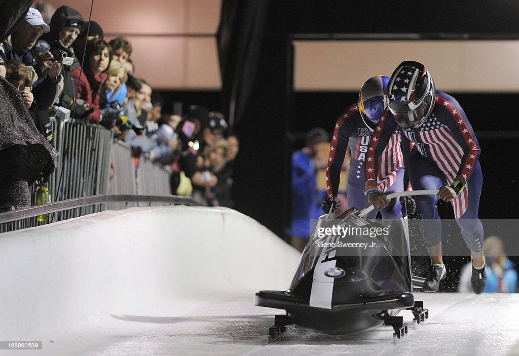 Bobsled pilot <a gi-track='captionPersonalityLinkClicked' href=/galleries/search?phrase=Jazmine+Fenlator&family=editorial&specificpeople=9988437 ng-click='$event.stopPropagation()'>Jazmine Fenlator</a> and brakewoman Lolo Jones push their sled at the start of their first run during the selection runs at the Utah Olympic Park October 25, 2013 in Park City, Utah. With a combined two-run time of 1:39.92, they placed third.