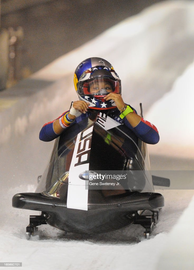 Bobsled pilot <a gi-track='captionPersonalityLinkClicked' href=/galleries/search?phrase=Jazmine+Fenlator&family=editorial&specificpeople=9988437 ng-click='$event.stopPropagation()'>Jazmine Fenlator</a> looks at the time as she and her brakewoman Lolo Jones finish their second run during the selection runs at the Utah Olympic Park October 25, 2013 in Park City, Utah. Their combined two-run time of 1:39.92 placed the pair third.