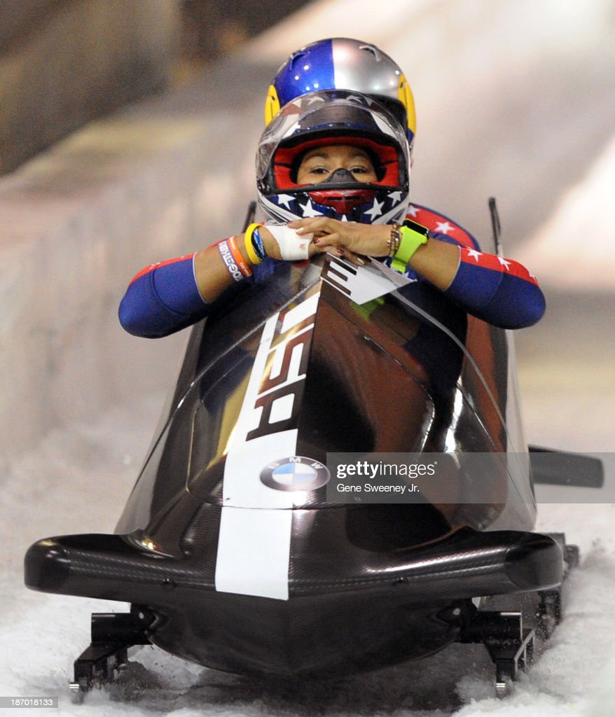 USA bobsled team of pilot <a gi-track='captionPersonalityLinkClicked' href=/galleries/search?phrase=Jazmine+Fenlator&family=editorial&specificpeople=9988437 ng-click='$event.stopPropagation()'>Jazmine Fenlator</a> and brakewoman Lolo Jones cross the finish line after the second of two selection runs at the Utah Olympic Park October 25, 2013 in Park City, Utah.