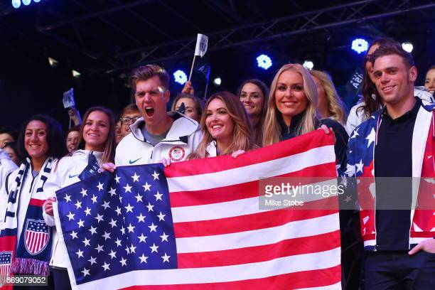 Bobsledder Elana Meyers Taylor snowboarder Alex Deibold skier Lindsey Vonn skier Gus Kenworthy and members of Team USA pose for a photo during the...