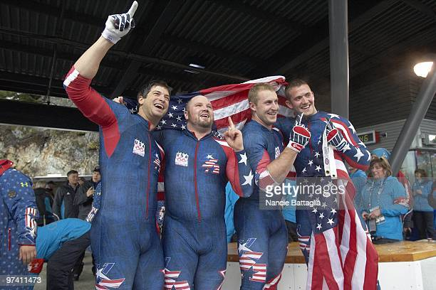 2010 Winter Olympics USA Team 1 Steve Mesler Steven Holcomb Curtis Tomasevicz and Justin Olsen victorious after winning Men's Bobsled Four Man Final...