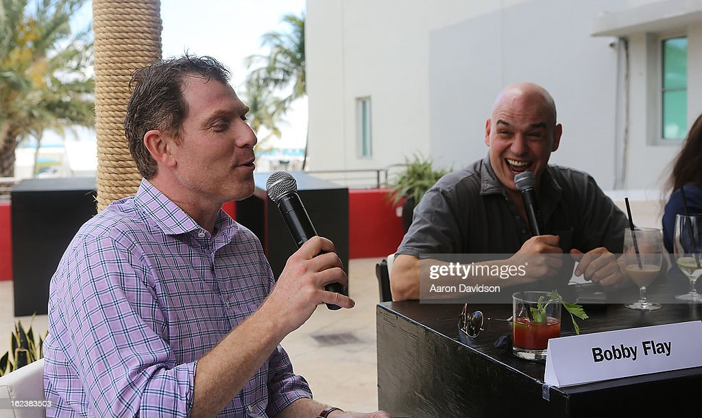 Boby Flay Ê and ÊMichael Symon attends What It Takes To Be An Iron Chef at Hotel Victor on February 22, 2013 in Miami Beach, Florida.