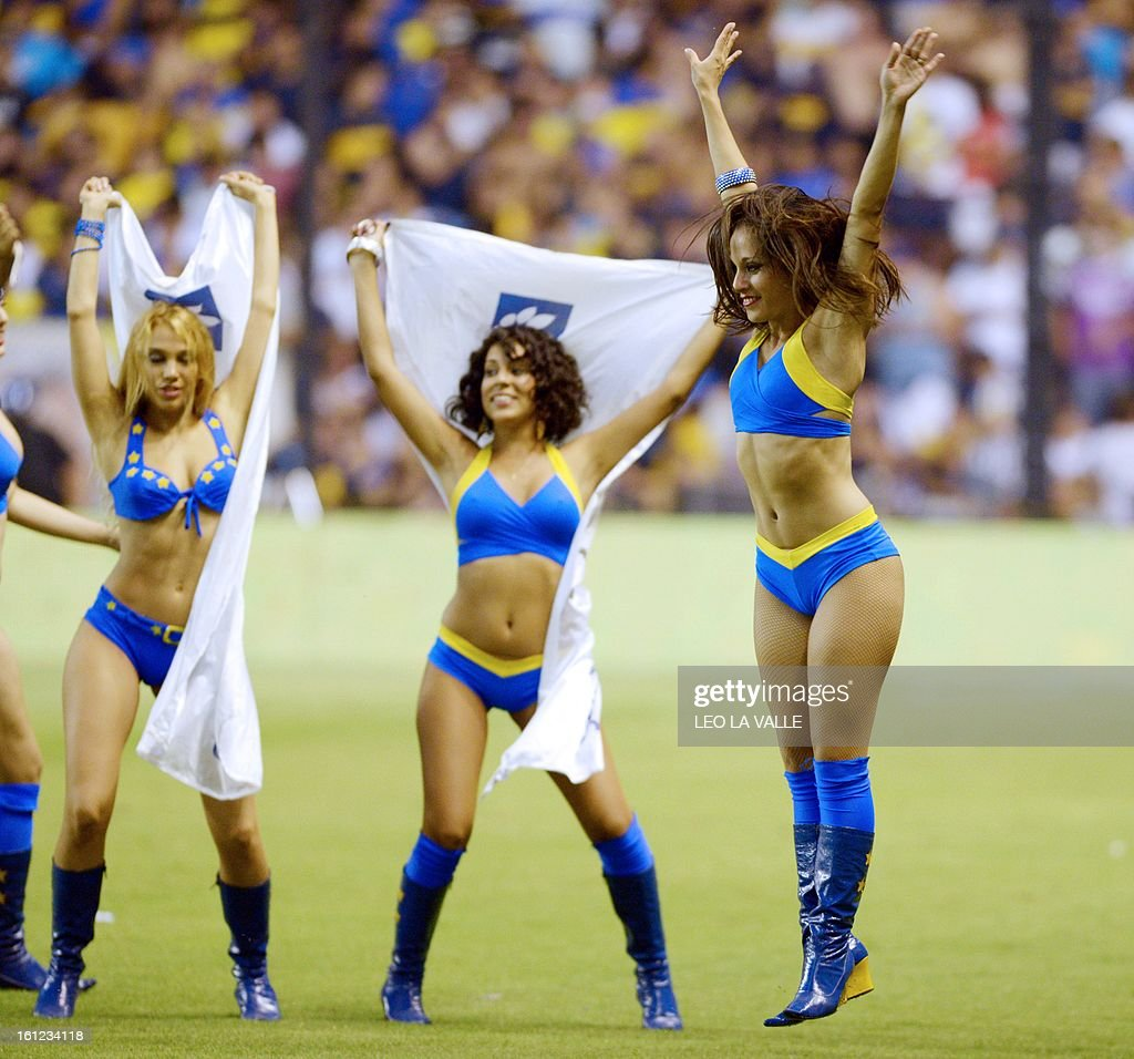 Boca Juniors' cheerleaders perform during the halftime of the Argentinian first division football match against Quilmes, at La Bombonera stadium in Buenos Aires, Argentina, on February 9, 2013. AFP PHOTO / LEO LA VALLE