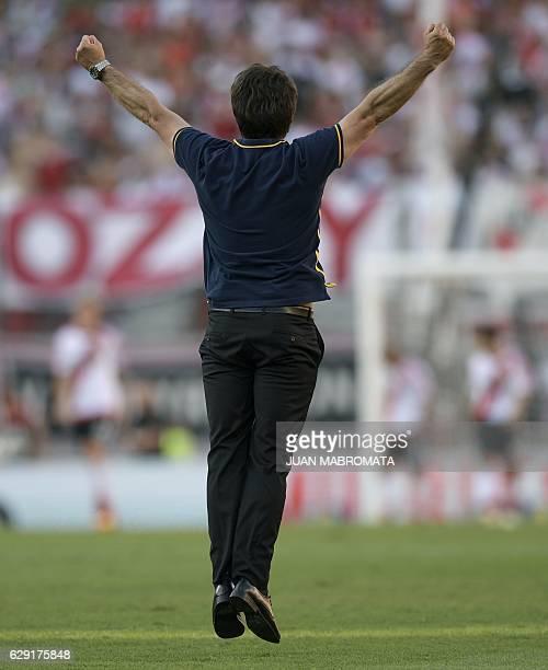 Boca Juniors' coach Guillermo Barros Schelotto celebrates after forward Ricardo Centurion scored the team's fourth goal against River Plate during...