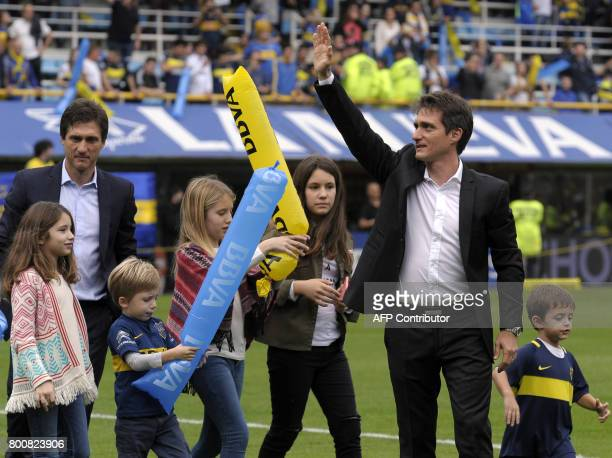 Boca Juniors' coach Guillermo Barros Schelotto his brother and assistant Gustavo and their children celebrate after the team defeated Union and won...