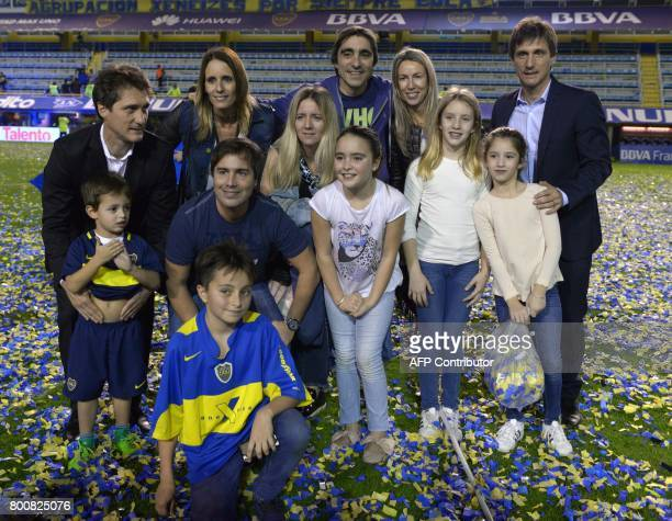 Boca Juniors' coach Guillermo Barros Schelotto his brother and assistant Gustavo and their families pose for a picture during the celebration after...