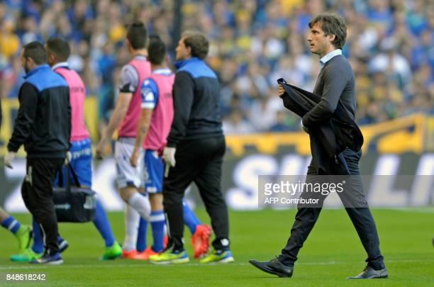 Boca Juniors coach Guillermo Barros Schelotto walks to the bench before their Argentina First Division Superliga football match against Godoy Cruz at...