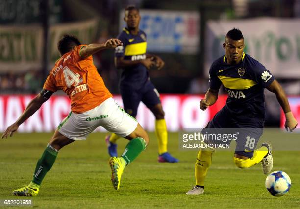 Boca Juniors' defender Frank Fabra vies for the ball with Banfield's defender Ismael Quilez during their Argentina First Division football match at...