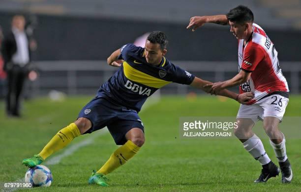 Boca Juniors' defender Leonardo Jara vies for the ball with Estudiantes' forward Ezequiel Umeres during their Argentina First Divsion football match...