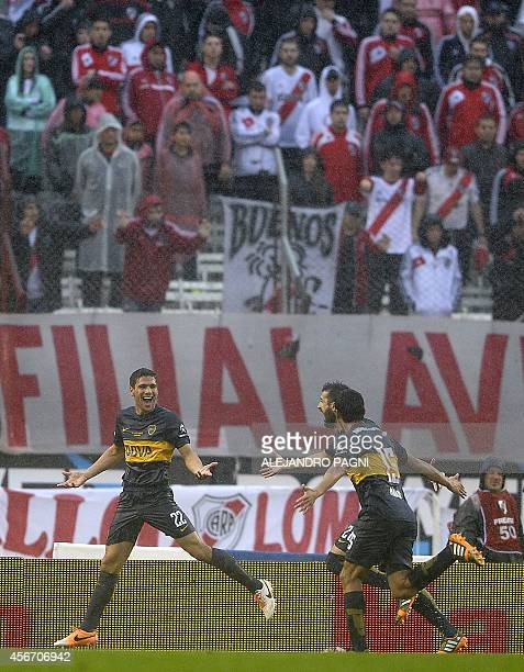 Boca Juniors' defender Lisandro Magallan celebrates after scoring a goal against River Plate during their Argentine First Division football match at...
