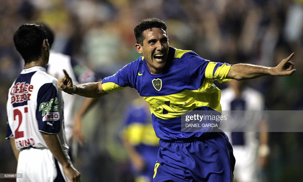 Boca Juniors' Diego Cagna celebrates after scoring the first goal against Pachuca 06 April 2005 during their Libertadores Cup Group 8 soccer match at...
